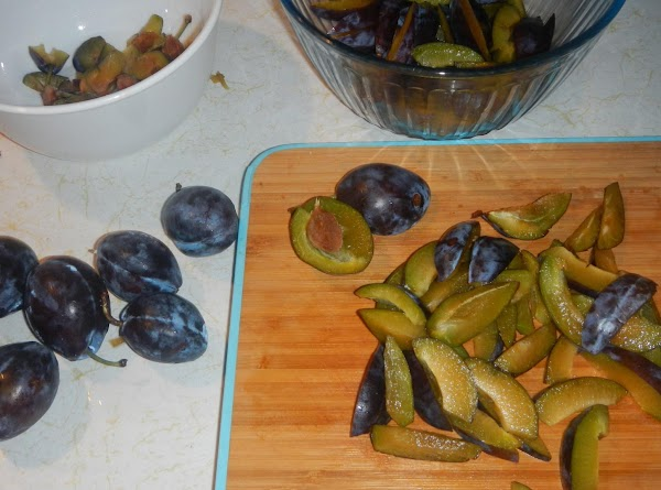 Cut the plums in half  and remove  the pit. Slice the halves into...