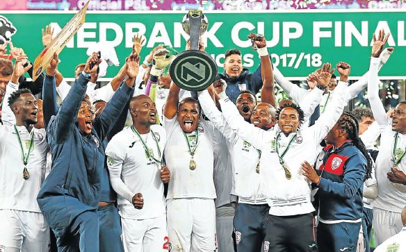 Free State Stars players celebrate winning the 2018 Nedbank Cup final against Maritzburg United at Cape Town Stadium.