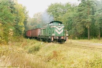 Photo: SM42-457 ze składem próżnych węglarek z EC Toruń Zachód {Toruń; 2003-10-25}