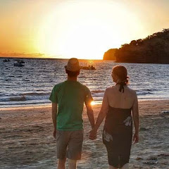 Walking on beach at sunset happy couple in Madagascar | Krys Kolumbus Travel