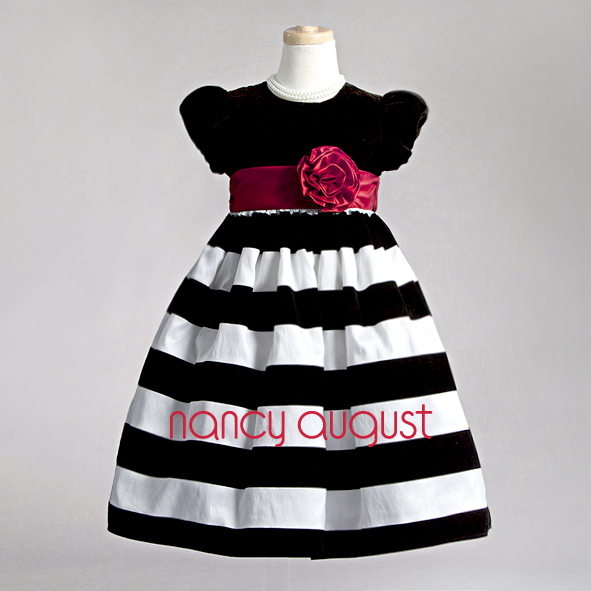 Photo: Today's Black & White Striped Baby Dress: In today's world we see the bold black and white design all over design shows, fashion runways, and even style magazines. Here it is perfectly translated into a itsy bitsy bite size dress for our precious little girls. This modern black and white striped baby dress is bold and a absolute vintage classic. The style of this baby dress is simple but the black velvet bodice and the striking wide striped skirt transforms this style into a bold swanky dress.