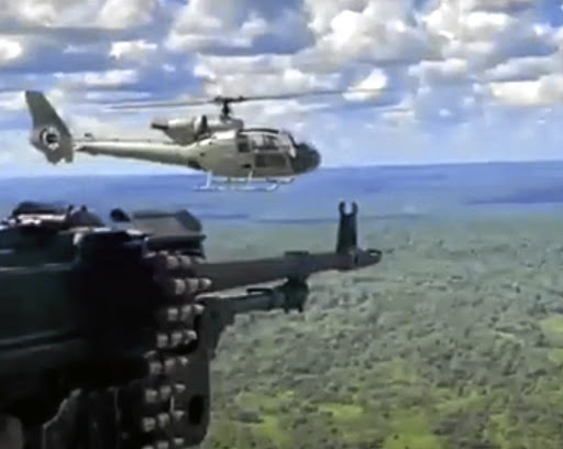 Screen grabs show DAG operatives during combat missions in support of the Mozambican police fighting an insurgency in northern Cabo Delgado province.