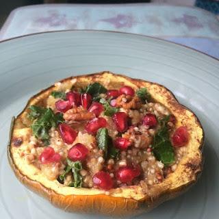 Twice Baked Acorn Squash Quinoa & Kale with Pomegranate