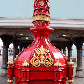 Crest on the Pump by DJ Cockburn - Artistic Objects Antiques ( steel, faversham, britain, house, building, decorated, red, kent, uk, faversham town pump, terrace, drinking fountain, victorian, architecture, crest, england, listed building, upward view, ornate, metal, engineering, home, market, guildhall, water pump )