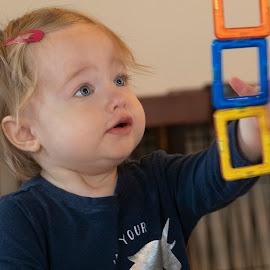 Squares by Jack Nevitt - Babies & Children Babies ( closeup, squares, playing, infant, inside, blue eyes )