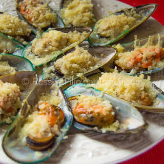 Baked Mussels With Cheesy Garlic Butter Topping.