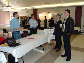 Photo: Patrick St-Onge (center) at the WBBP desk