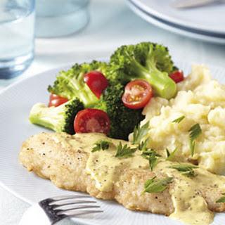 Witte vis met Mosterdsaus, broccoli en cherrytomaatjes