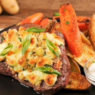 Bleu Cheese-Crusted Sirloin Steak With Roasted Fingerling Potatoes, Carrots, and Horseradish Cream