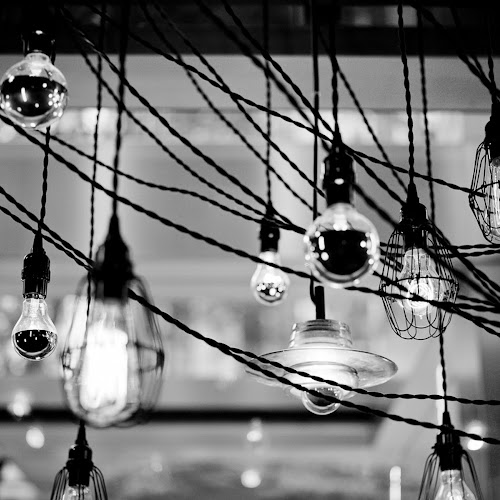 Artistic shot of a string of pendant lights found inside Earls restaurants