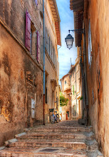 Photo: Street in Arles, France - This is Arles, which is only a short drive from Montpellier and less than an hour from the Côte d'Azur. The streets are quaint and quiet. There are a few tourist areas, but after a few steps in a random direction, you're back in the old streets. I needed to stay for longer for more exploration (!), but I did my best to make use of the short time I was there. - from Trey Ratcliff at http://www.StuckInCustoms.com - all images Creative Commons Noncommercial