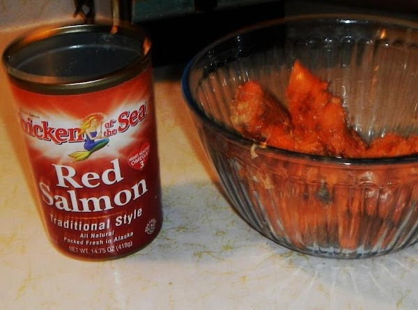 Drain can of salmon,  prepare salmon ready to add to salad. Set aside.