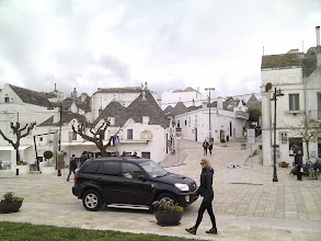 Photo: The modern and the old meeting in Unesco-heritage town of Alberobello. There are many towns with those beautiful trullis in Puglia, you can also see them scattered around countryside, especially around Itra valley