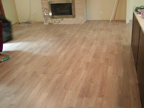 Photo: laminated flooring installation light color.