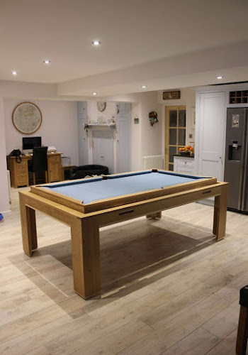 Elevated Light Blue Spartan Pool Table in a dining room