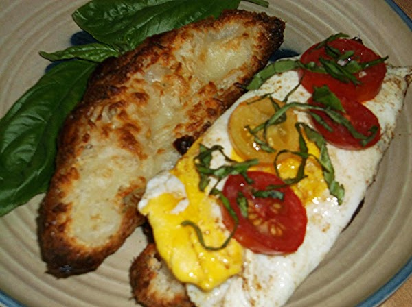 Scatter chiffonade of basil over tomatoes; place remaining croissant half, cheese side down, on...