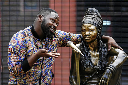 Bongani Fassie with a bronze image of his late mother, Brenda Fassie.