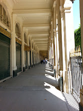 Photo: Le Palais Royal - Louis XIV lived here before Versailles. It became the HQ for duc d'Orleans, who used to host 'debating clubs' here, the precursors to political parties. Madam Tussaud's first wax shop was built here! (Read up on her part in the French Revolution - grisly). In 1781, duc d'Orleans had to rent it to raise money - it became a 19th century mall. Today, it's a govt building, from behind which you can see the National LIbrary.
