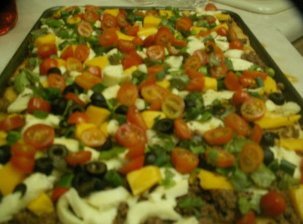 Added the tomatos and black olives.  Placed in the oven at 350 degrees...