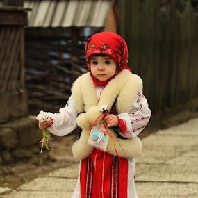 Little peasant by Nicu Buculei - Babies & Children Children Candids ( girl, village, street, romania, dragobete, , red, white, pwc87 )