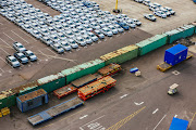 New automobiles sit in the vehicle import yard in Durban.