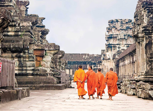 monks-in-angkor-wat - Four monks walk down the streets of Angkor Wat, Cambodia, on a Lindblad Expeditions tour of this region.
