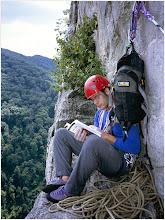 Photo: Conn's East 5.5. Alex Dynkin reading route description. On a ledge before second pitch. Seneca Rocks, WV. 5.5 Aug. 1, 2004 FujiGA645ZI.