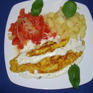 Weißfischfilet in Kräuter-Frisch-Käse-Sauce.
