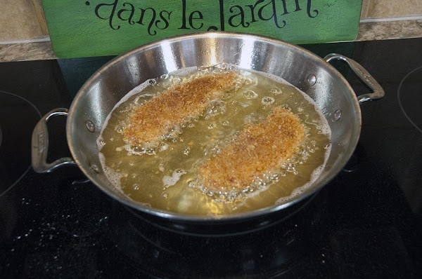 Cook the chicken tenders until golden brown, about 2-3 minutes per side.