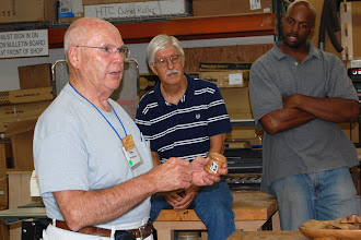 Photo: Bob Browning shows off his stamp roll box that he made from some old oak he had laying around the shop.