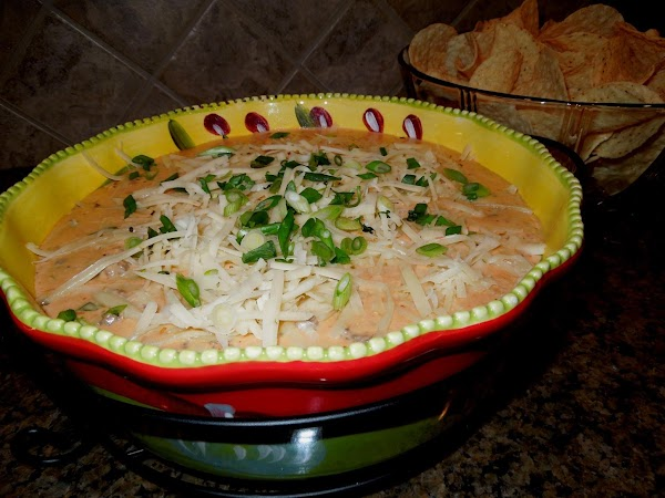 Remove the dip from the heat, and pour carefully into your slow cooker, or...
