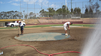 Photo: Digging out the edge of the mound prior to sodding.