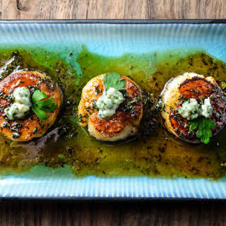 Scallops with a Honey Parsley Gastrique and Blue Cheese.