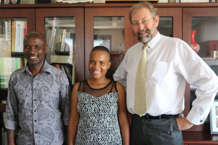 Triphin Mudzvengi with her proud father Polate Mudzvengi and Ian Jandrell, head of the faculty of engineering and the built environment at Wits University.