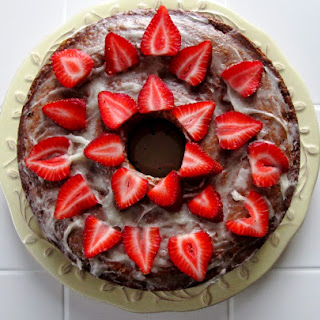Honey Yogurt Cake with Honey Cream Glaze and Fresh Strawberries.
