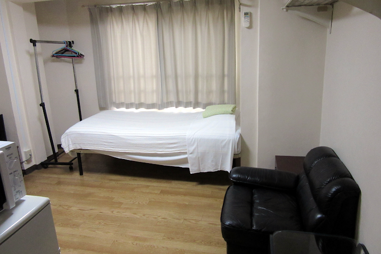 Simplistic living area in Koto-Ku Serviced Apartment