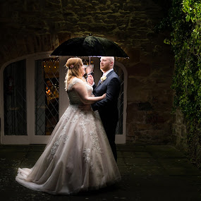 Out in the cold for a warm embrace by Nigel Hepplewhite - Wedding Bride & Groom ( lights, love, wedding, umbrella, couple, ivy, bride, groom )