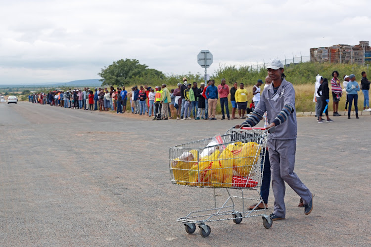 Residents of Letlhabile, North West and the surrounding village queuing to get into Letlhabile mall to buy food on day two of SA's 21-day lockdown on March 27 2020.
