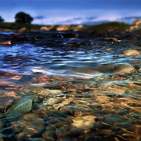 An elemental melody. by BethSheba Ashe - Landscapes Waterscapes ( water, ripples, pebbles, wet, dof, stones, evening, river )