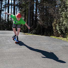 Skateboarder in Action by Garry Dosa - Babies & Children Children Candids ( sports, outdoors, action, skateboarding, people, boy, march, park, child )