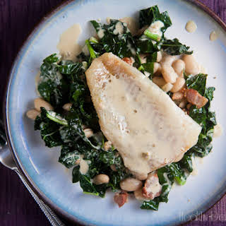 Seared Cod with Mustard Cream Sauce over White Beans and Kale.