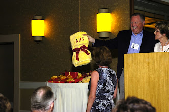 Photo: David Gilmour presenting award to Barbi Knopp Wesser for contacting and encouraging most classmates to attend