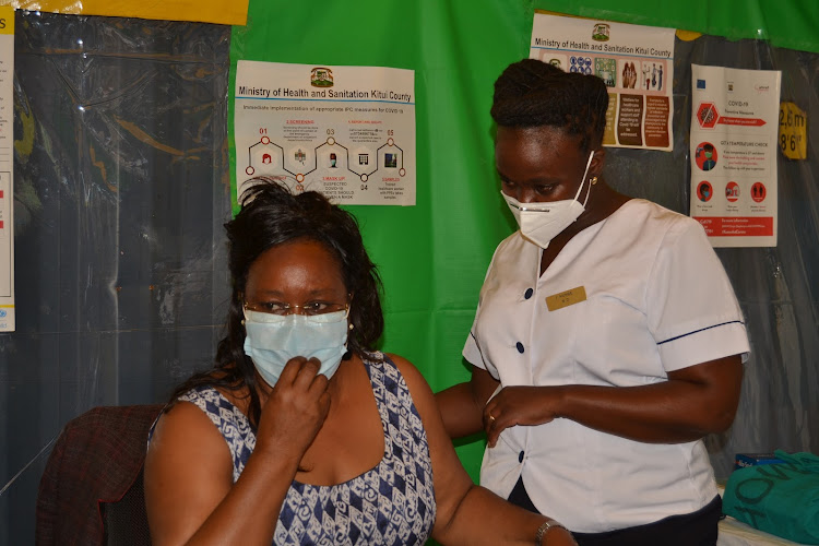 Kitui health executive Winnie Kitetu prepares to get vaccinated on March 10, 2021 at the Kitui County Referral Hospital