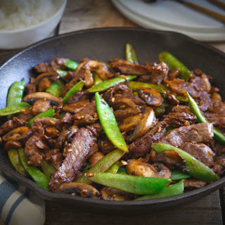 Skillet Asian beef with snow peas and mushrooms.