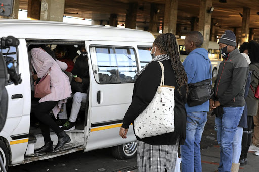 Fill up: Commuters at Baragwanath taxi rank where taxis are back to full capacity in, Soweto. Picture: Sowetan/Antonio Muchave