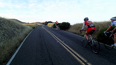 Photo: Carl Sanders (foreground in red) and Rod Palomino in front on Ridgecrest Road, Mt Tam