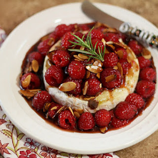 Warm Honeyed Brie with Raspberries and Almonds.
