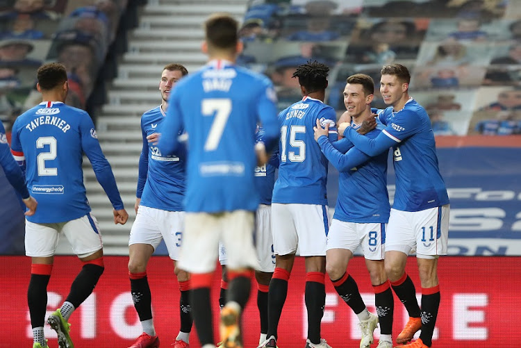 Ryan Jack of Rangers celebrates with teammates Bongani Zungu and Cedric Itten after scoring his team's fourth goal during the Ladbrokes Scottish Premiership match between Rangers Ross County at Ibrox Stadium on January 23, 2021 in Glasgow, Scotland.
