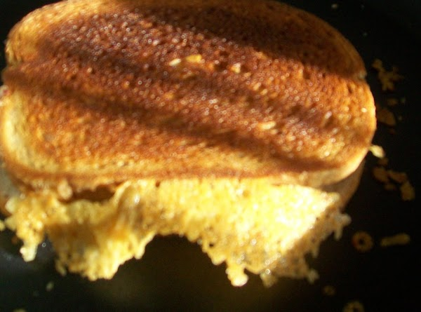 Put the second slice of bread on top { buttered side up } grille...