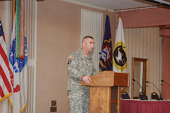 Photo: Lt. Col. Joe McLamb delivers remarks for the tactical issues portion of the symposium.